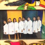 """The first Adelante Mujer doctorstaken, asked the artist to add """"Adelante Mujer"""" to the painted"""